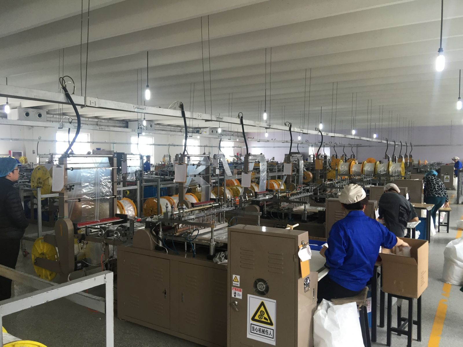 2f025030f543 About Us  Team · Plastic bags factory ...